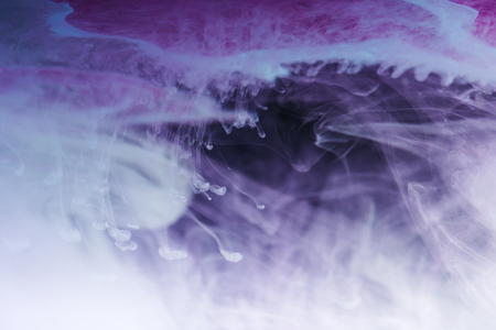 Abstract blue, white and purple artistic background with flowing ink Stock Photo