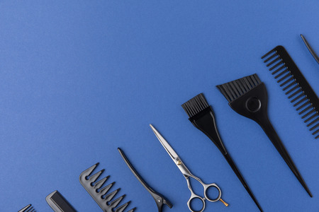 Diagonal composition with hairdressing tools, isolated on blue background
