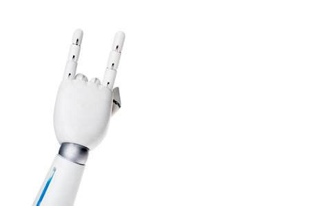 Cropped shot of robot showing rock gesture isolated on white background