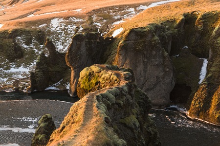 Majestic natural view of small river, rocks and snow in Iceland 写真素材