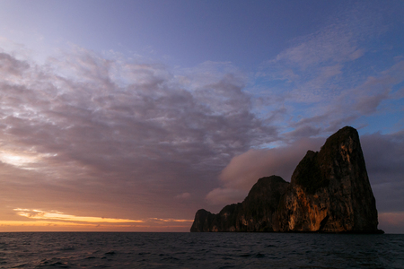 Scenic view of sunset over rocky formation and ocean, Phi Phi islands Stok Fotoğraf