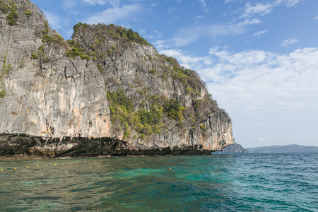 Beautiful scenic view of rocky formations covered with plants and ocean, Phi Phi islands Stok Fotoğraf