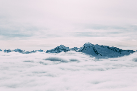 Majestic snow-capped mountain peaks and clouds, Mayrhofen, Austria