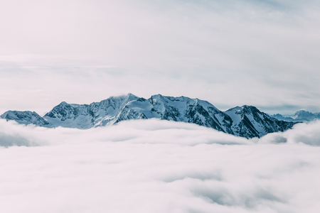 Amazing winter mountain landscape with clouds, Mayrhofen, Austria