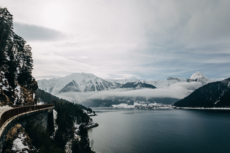 Beautiful scenic landscape with snow-covered mountains and tranquil mountain lake in Austria 写真素材