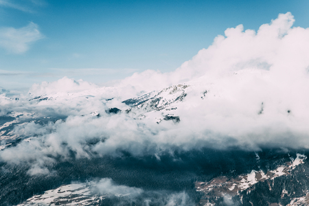 Beautiful alpine landscape with snow-capped mountains and clouds, Mayrhofen, Austria