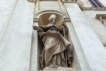 Religious statue on building facade in Rome