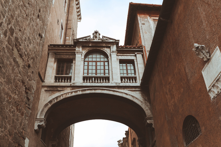 Archway between two buildings in historical quarter of Rome