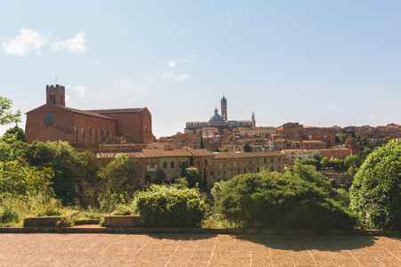 View of Sienna city and tower on sunny day Фото со стока