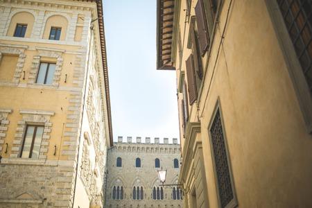 Walls of medieval buildings in city of Sienna