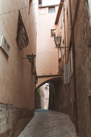 Steep street in historical quarter of Sienna Stok Fotoğraf