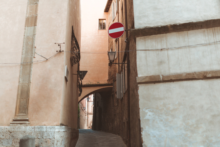 Road sign on building in street of Sienna