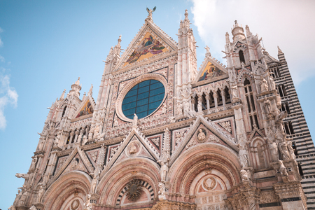 Sienna Cathedral facade with rose window and mosaic