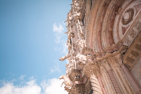 Gargoyles and Saints on facade of Sienna Cathedral
