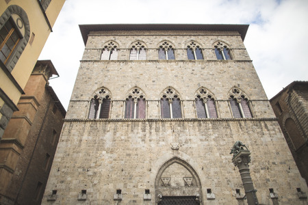Windows in Gothic style on old building in Sienna