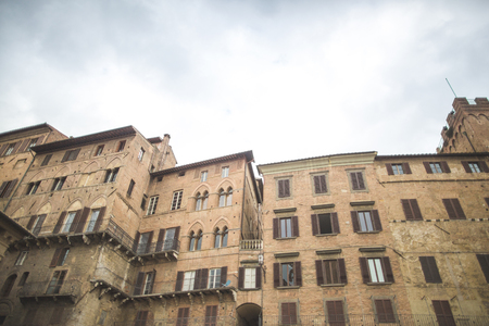 Tuscany architectural buildings on street in Sienna 免版税图像