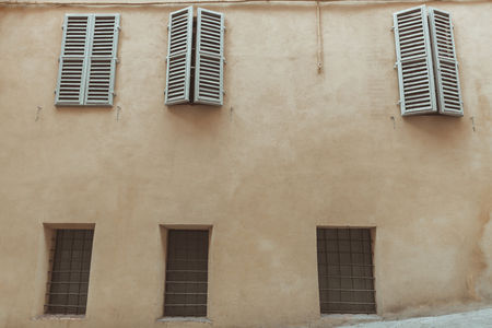 Windows with shutters of Sienna old building