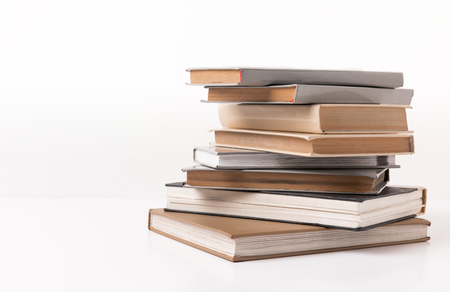 Pile of different books isolated on white background