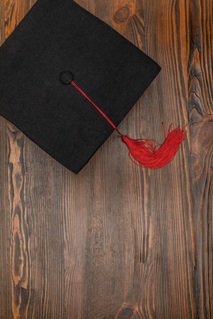 Top view of square academic cap on wood background Stockfoto