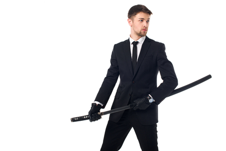 Portrait of agent in suit and gloves with katana isolated on white background