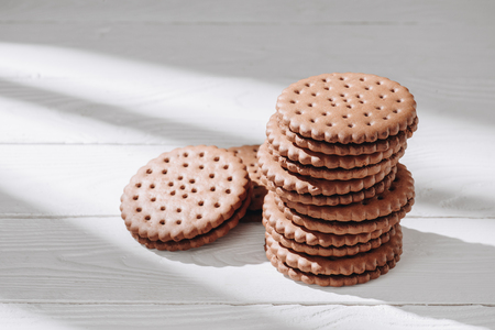 Close-up shot of delicious chocolate cookies on white wooden tabletop Stok Fotoğraf