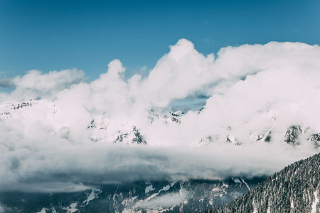 Majestic snow-covered mountains and white clouds in Mayrhofen, Austria 写真素材