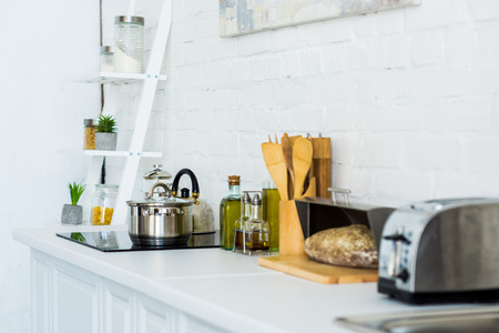 Toaster and electric stove in light modern kitchen Stockfoto