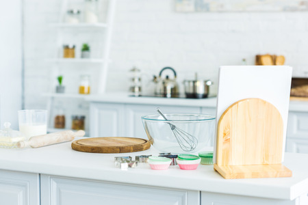 Cutting board and bowl with whisk on kitchen counter