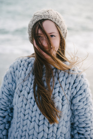 Portrait of beautiful smiling girl with long hair in hat and trendy merino sweater Archivio Fotografico - 111004539