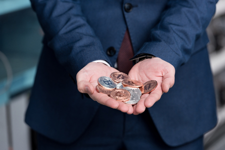 cropped shot of businessman with heap of bitcoins in hands Stock Photo