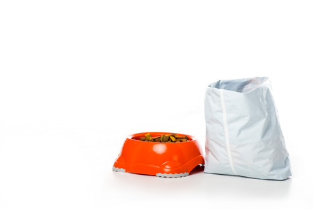 close-up view of plastic bowl and bag with animal food isolated on white