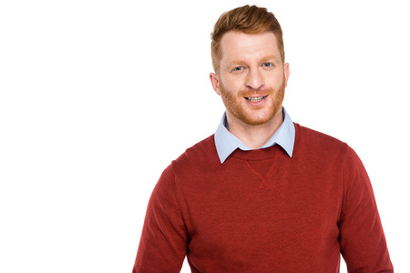 portrait of handsome bearded redhead man smiling at camera isolated on white