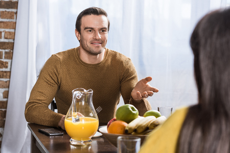 selective focus of couple talking during breakfast at home Stock Photo