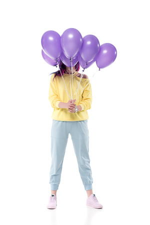 stylish young woman covering face with bunch of helium balloons isolated on white 写真素材