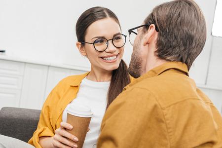 close-up shot of couple flirting and drinking coffee Фото со стока