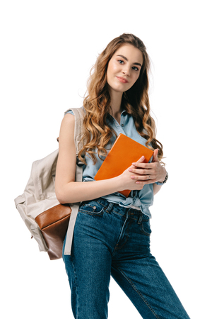 beautiful student holding book and looking at camera isolated on white Imagens