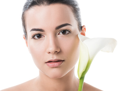 beautiful girl holding white calla flower and looking at camera isolated on white Zdjęcie Seryjne