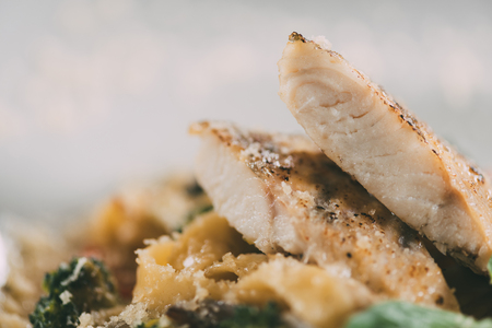 close-up view of delicious pasta with pike perch fillet and parmesan cheese