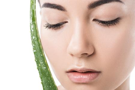 headshot of beautiful girl touching face with aloe vera leaf isolated on white