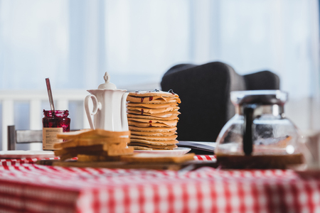 close-up view of tasty breakfast with toasts, pancakes and coffee on table 版權商用圖片