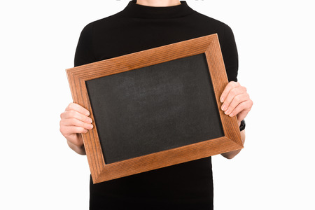 Partial view of woman holding empty blackboard isolated on white