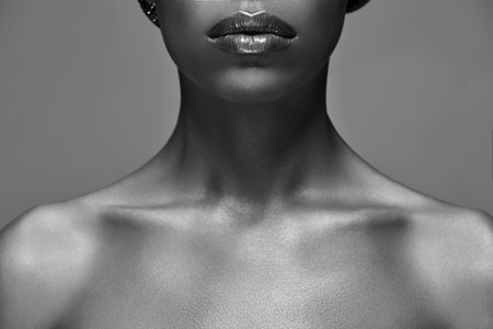 Black and white photo of African American woman isolated on grey background