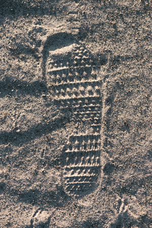 Top view of footprint on sand