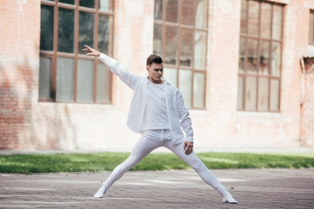 Handsome young dancer performing modern dance on street Foto de archivo - 111223809