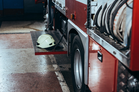 Close up view of protective helmet on fire truck at fire station Stock Photo