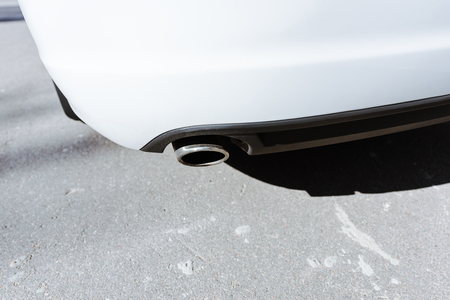 Cropped image of exhaust pipe in white car