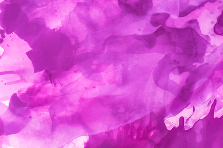 Beautiful violet splashes of alcohol ink as abstract background