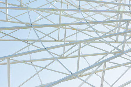 Metallic parts of observation wheel construction against blue sky background Stock Photo