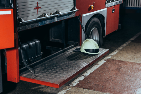 Close up view of protective helmet on fire truck at fire department Stock Photo