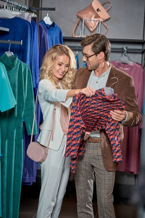 Happy young couple shopping together in boutique Foto de archivo - 111569639
